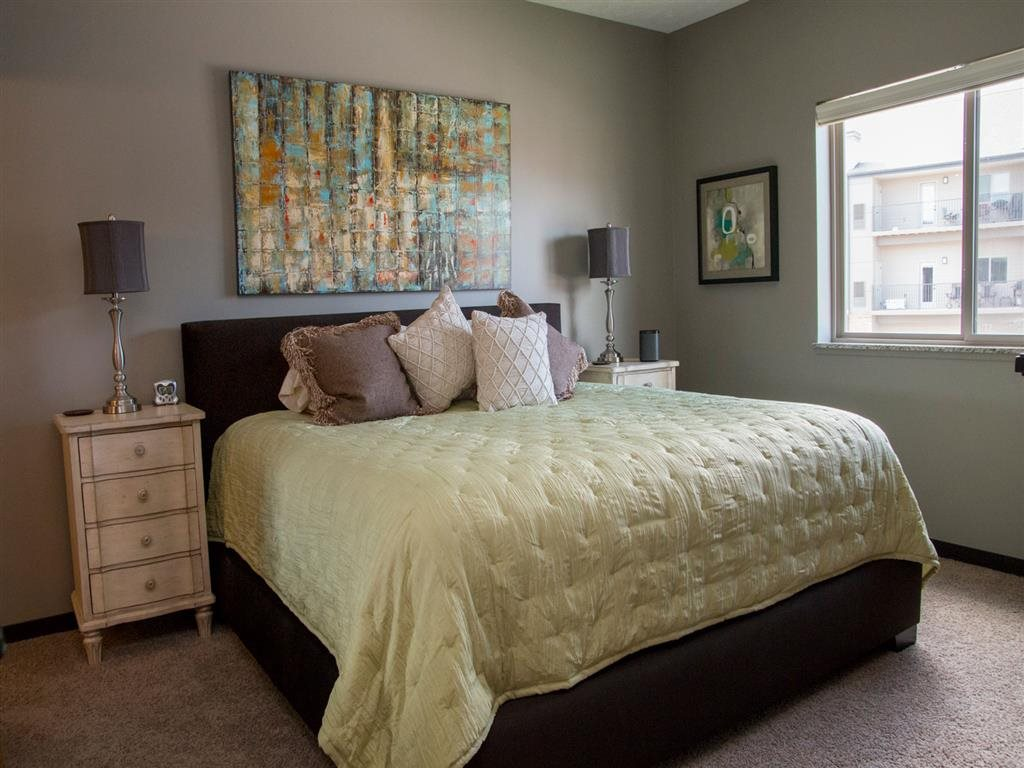 Bedroom with queen-size bed at The Flats at 84 apartments in Lincoln NE