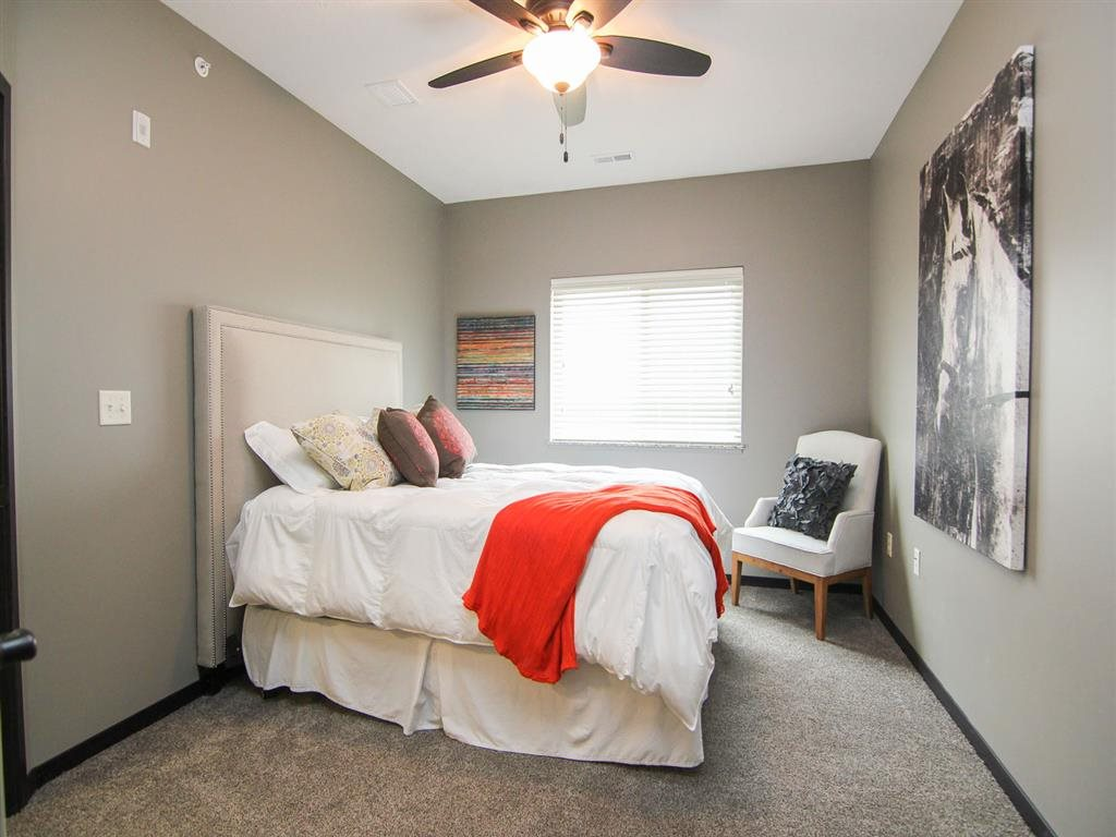 Bedroom with ceiling fan at The Flats at 84 apartments in Lincoln NE
