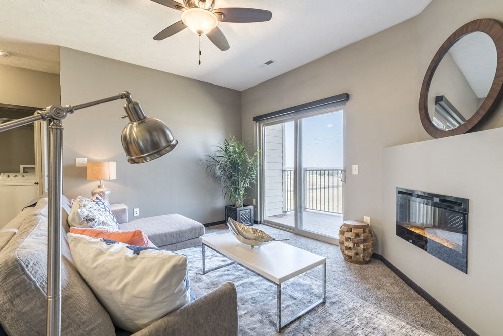 Open layout living room with fireplace at The Flats at 84 in southeast Lincoln NE 68516
