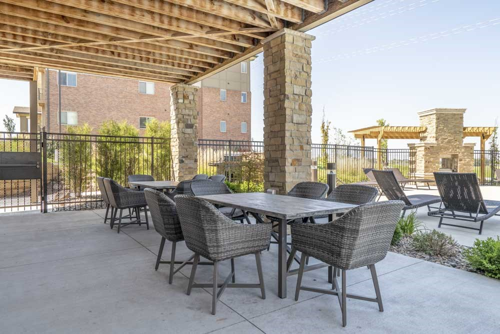 Pool-side tables and seating at The Flats at 84 in southeast Lincoln NE 68516