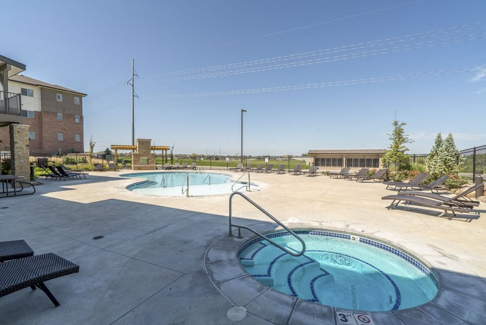 Hot tub and resort-style pool at The Flats at 84 in southeast Lincoln NE 68516
