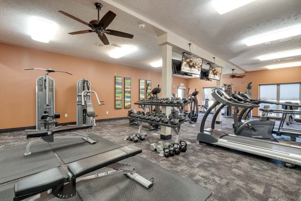24-hour fitness center with weights and treadmills at The Flats at 84 in southeast Lincoln NE 68516