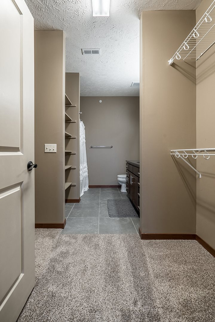 Interiors- Bathroom attached to expansive walk-in closet at the Villas of Omaha Butler Ridge in Omaha NE