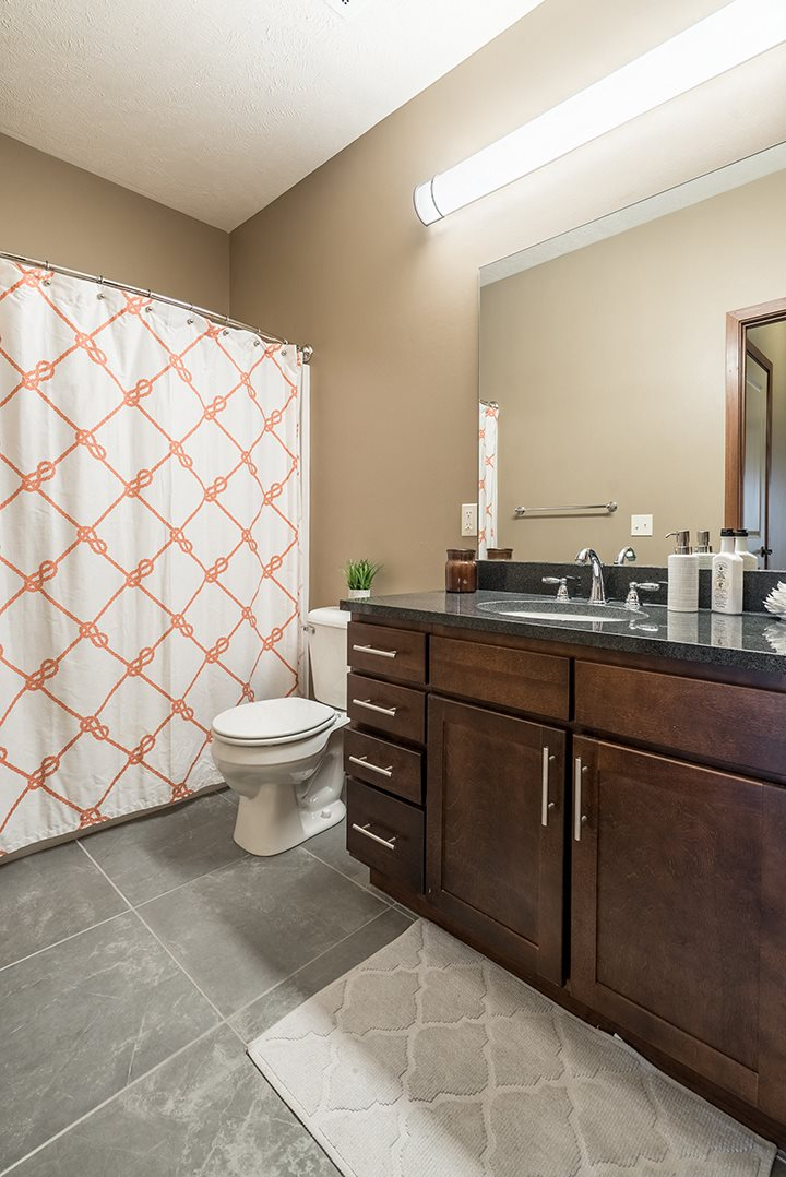 Interiors- Bathroom with lots of bright lighting at the Villas of Omaha Butler Ridge in Omaha NE