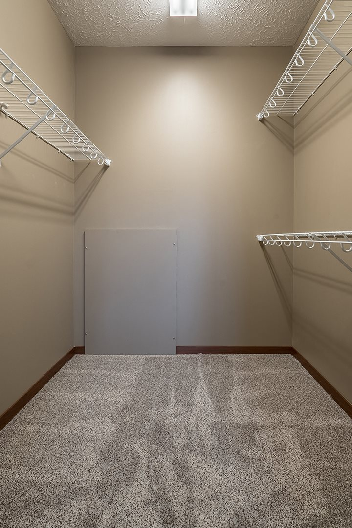 Interiors- Big walk-in closet for clothing and extra storage at the Villas of Omaha Butler Ridge in Omaha NE