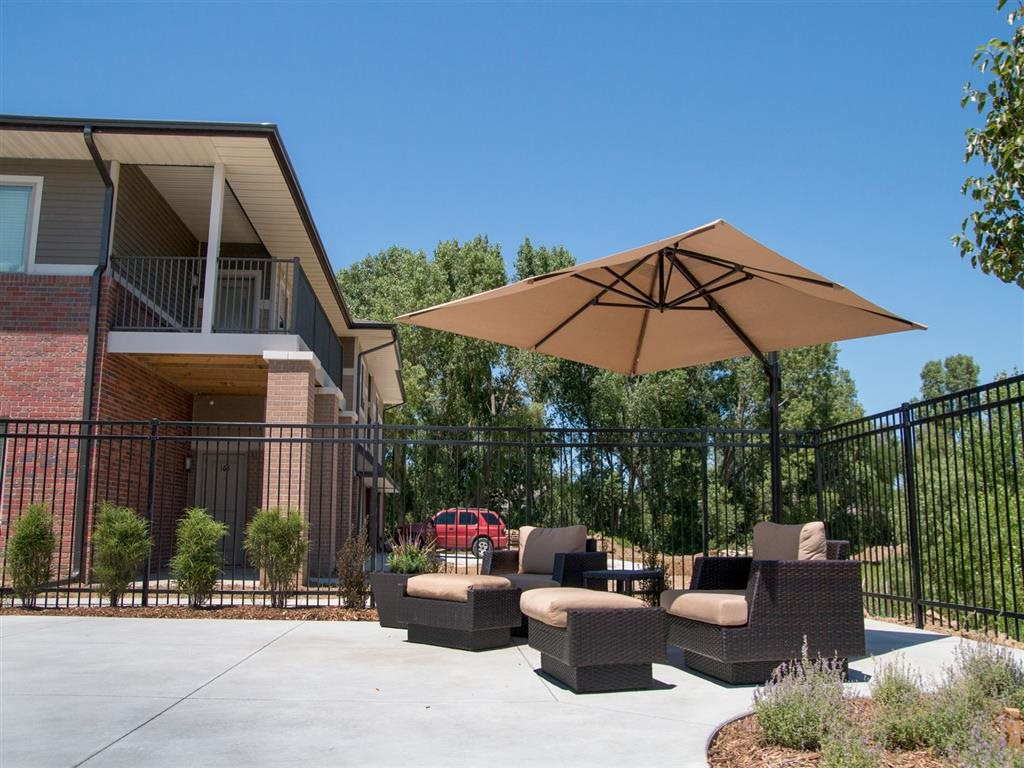Covered seating at swimming pool at Villas of Omaha at Butler Ridge