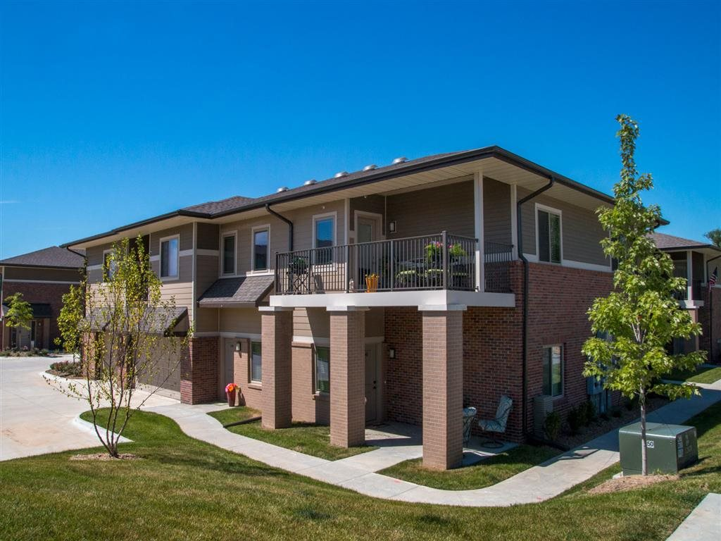 Townhouses with balconies at Villas of Omaha at Butler Ridge