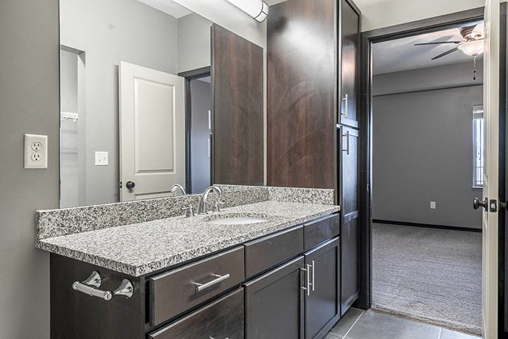 Interiors- Granite countertops vanity in Bathroom at the Villas of Omaha at Butler Ridge in Omaha Nebraska