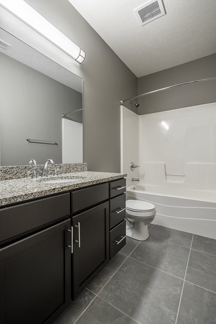 Interiors- Granite countertops and stand-up shower in Bathroom at the Villas of Omaha at Butler Ridge in Omaha Nebraska