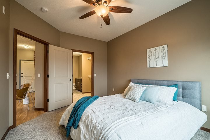 Interiors- Quiet and cozy bedroom at the Villas of Omaha Butler Ridge in Omaha NE
