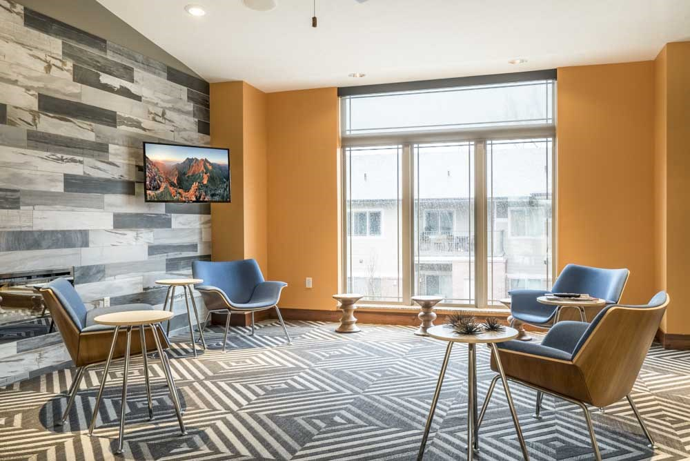 Leasing lounge with TV at Villas of Omaha townhome apartments in northwest Omaha NE 68116