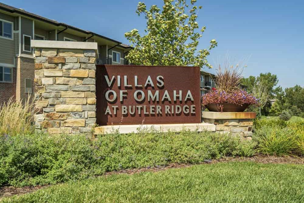 Entrance sign at Villas of Omaha townhome apartments in northwest Omaha NE 68116
