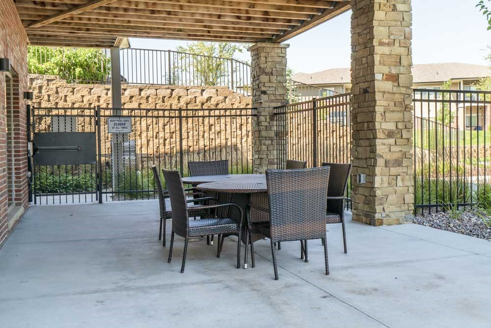 Outdoor seating by pool at Villas of Omaha in northwest Omaha NE 68116