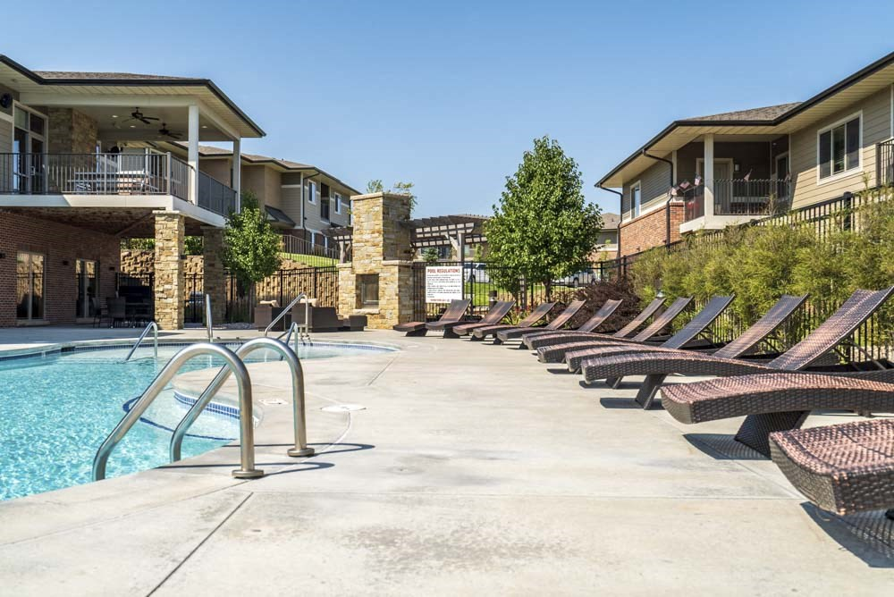 Lounge chairs by the pool at Villas of Omaha in northwest Omaha NE 68116
