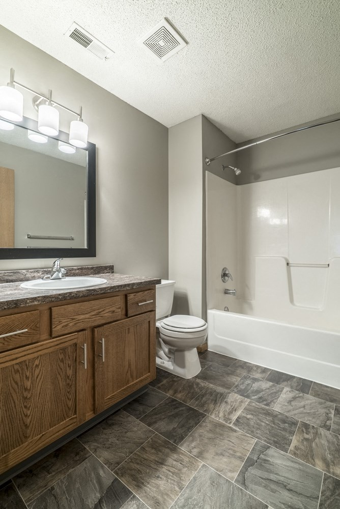 Interiors-Bathroom with bathtub and updated vanities and lighting