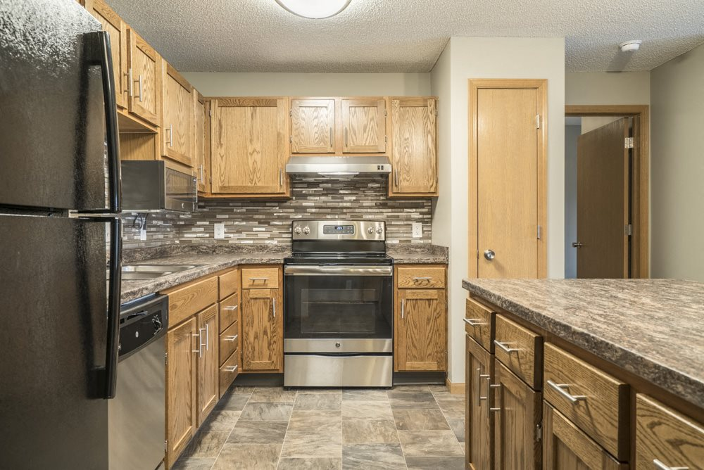 Interiors-Renovated kitchen with tile backsplash and new appliances at Highland View