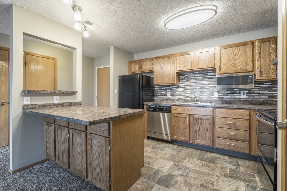 Interiors-Renovated kitchen with tile backsplash and new appliances