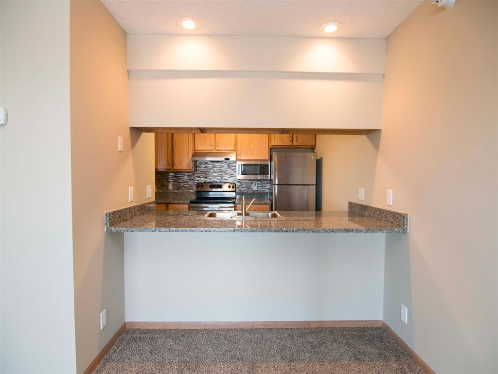 Interiors-Skyline View Apartments Updated Kitchen and Breakfast Bar in Lincoln NE
