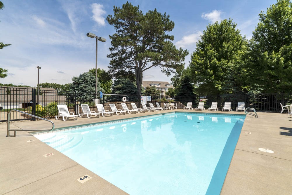 Pool with lounge chairs at Skyline View Apartments!