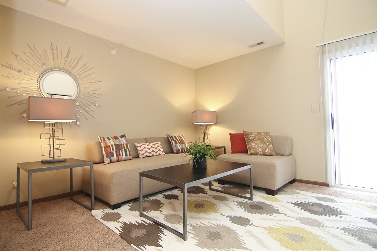 Bright natural lighting in living space at Pine Lake Apartments