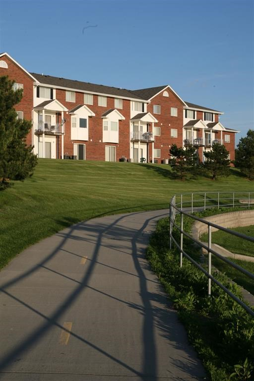 Exterior side with bike path at Pine Lake Heights Apartments in Lincoln Nebraska