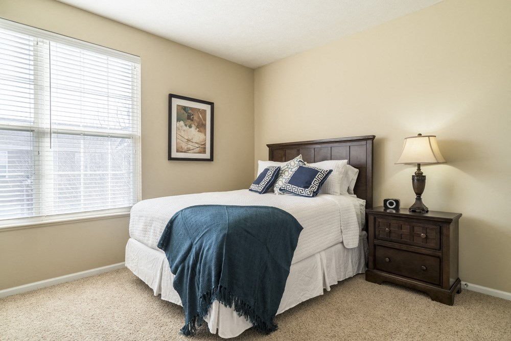 Interiors-Master bedroom with king-sized bed at Ridge Pointe Villas