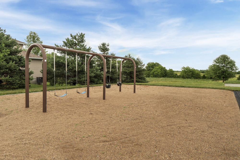 Swings at Schleich Park near Cascade Pines Duplex and Townhomes