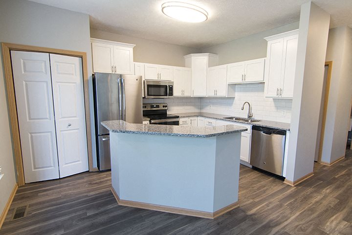 Interiors- Beautifully renovated kitchen with subway tile and hardwood-like flooring at Cascade Pines Town-homes Lincoln Nebraska
