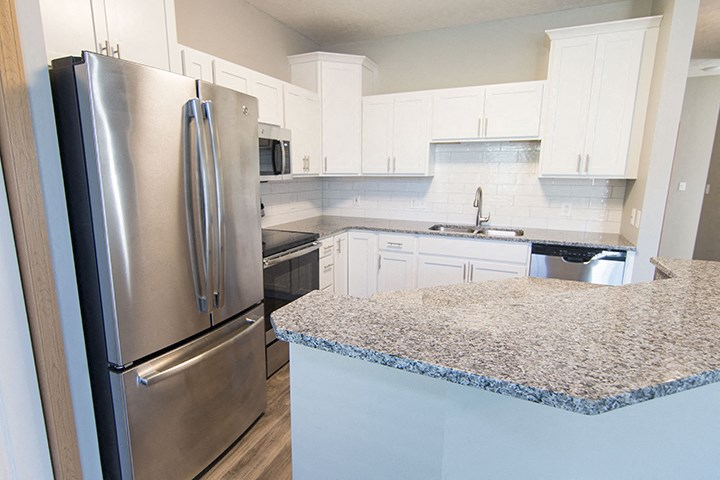 Interiors- Stainless-steel appliances and hardwood-like flooring at Cascade Pines Town-homes Lincoln Nebraska