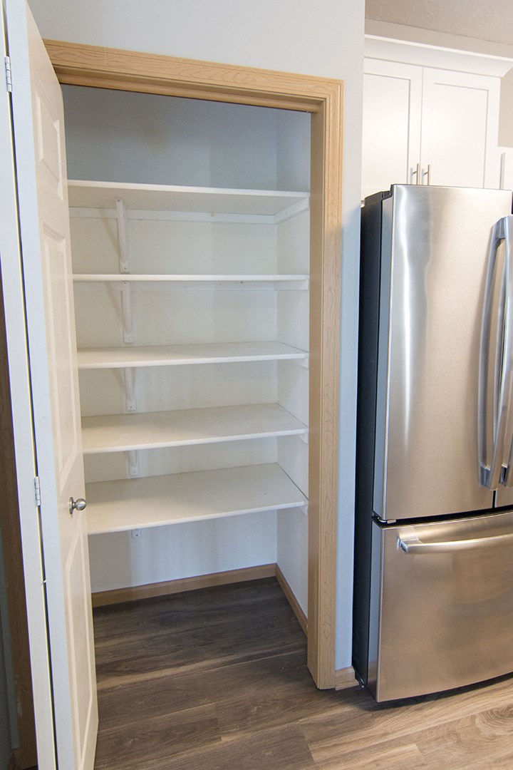 Interiors- Large pantry in kitchen for extra storage at Cascade Pines Town-homes Lincoln Nebraska