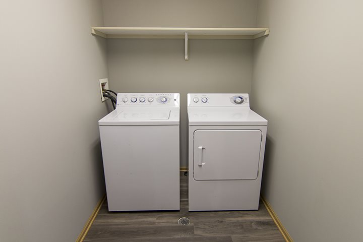 Interiors- Full-sized washer and dryer with hardwood-like flooring at Cascade Pines Town-homes Lincoln Nebraska
