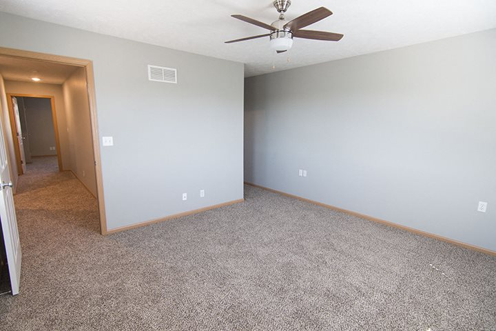 Interiors- Large bedroom with lots of lighting at Cascade Pines Town-homes Lincoln Nebraska