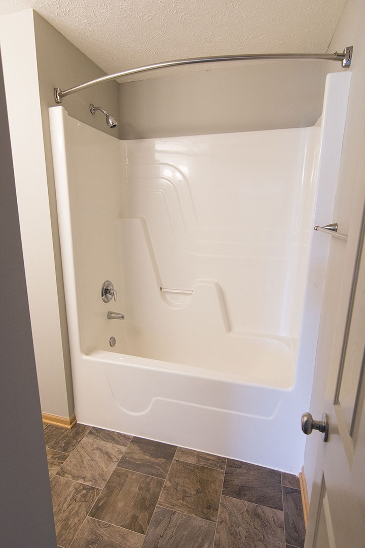 Interiors- Shower with curved curtain bar at Cascade Pines Town-homes Lincoln Nebraska
