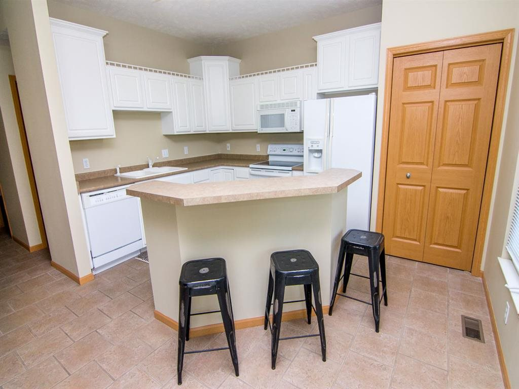 Interiors-Kitchen with Island Bar in Cascade Pines Duplex Homes in Lincoln NE