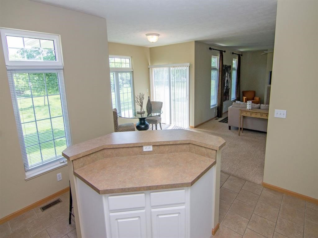 Interiors-View from Kitchen of Dining Room and Living Room at Cascade Pines Duplex Homes in Lincoln NE