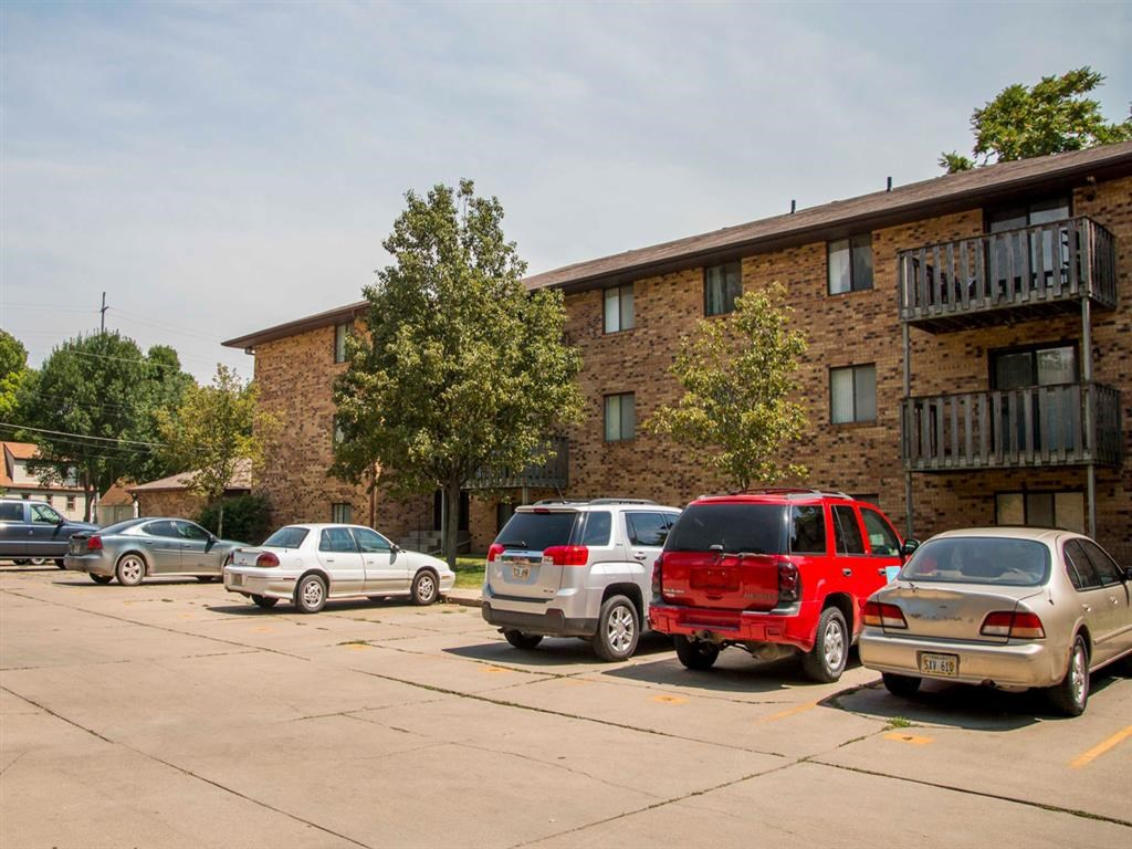exterior side with parking lot at Moore Place Apartments in Lincoln Nebraska
