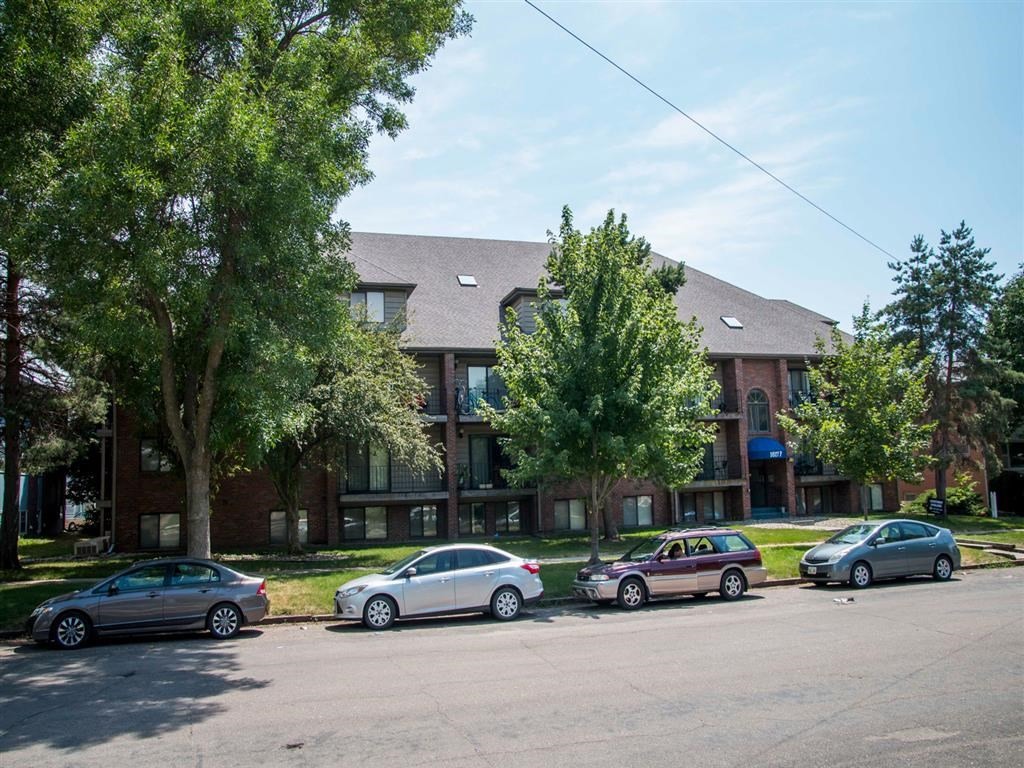 trees and landscaping around property at Packard House Apartments in Lincoln Nebraska