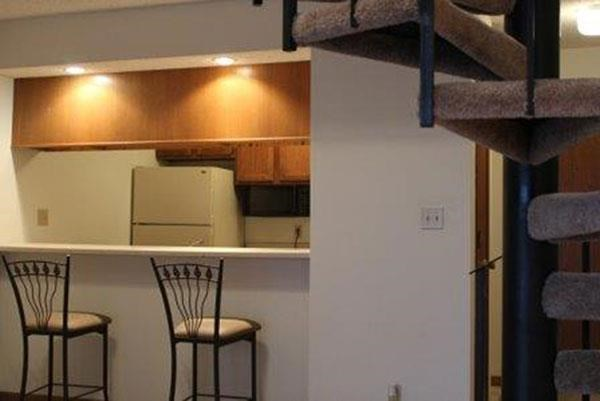 kitchen bar seating and stair case at Packard House Apartments in Lincoln Nebraska
