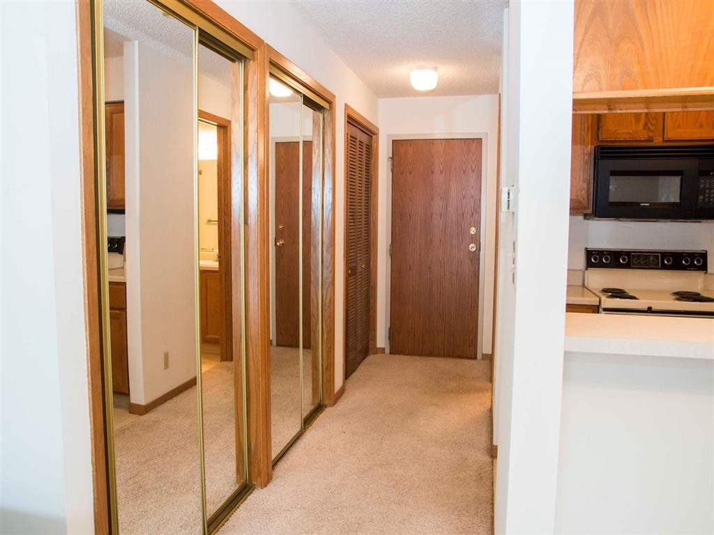 hallway including spacious closets at Capitol View Apartments in Lincoln Nebraska