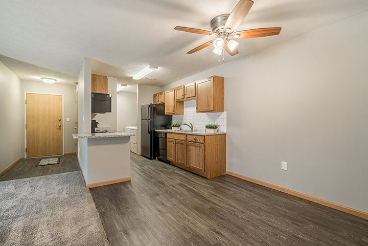 Kitchen with hardwood-style flooring at Williamsburg Park Apartments in Lincoln NE