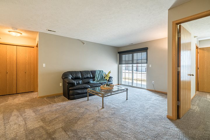 Large living space with abundant natural lighting at Williamsburg Park Apartments in Lincoln NE