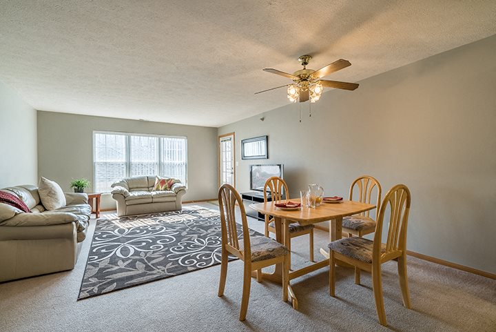 big living room with attached dining area at Williamsburg Park Apartments in Lincoln NE