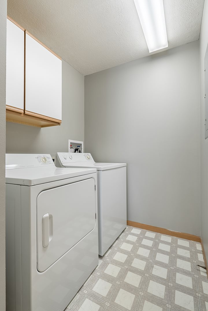 full-sized washer and dryer in laundry room at Williamsburg Park Apartments in Lincoln NE