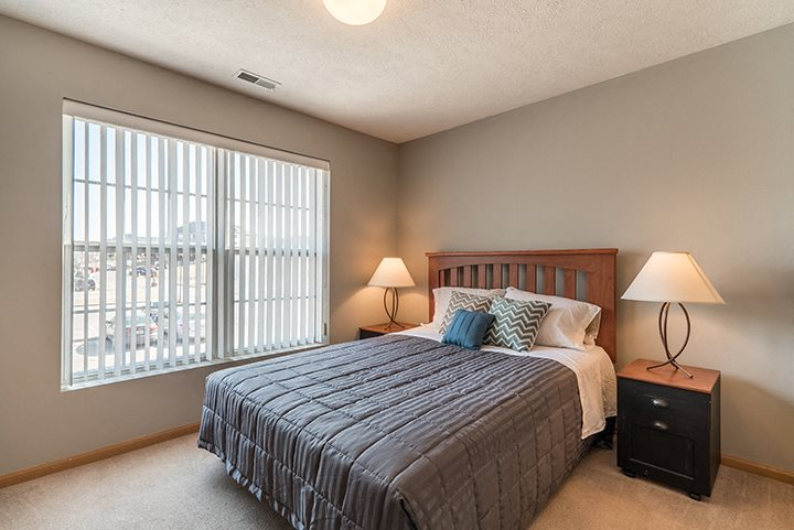 large bedroom with big window for lighting at Williamsburg Park Apartments in Lincoln NE