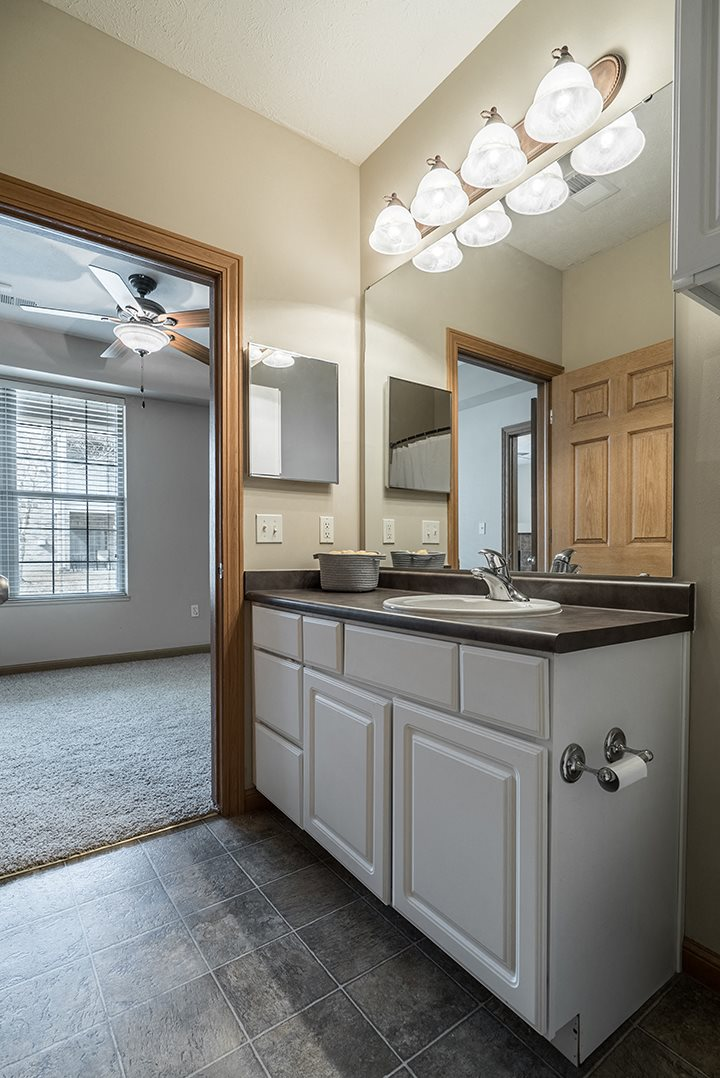 Interiors- Bright and spacious bathroom off of bedroom at Stone Creek Villas Apartments in Omaha Nebraska