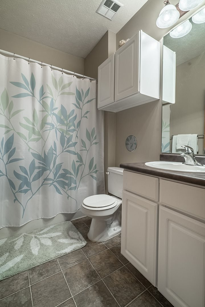 Interiors- Bright bathroom with lots of cabinets at Stone Creek Villas Apartments in Omaha Nebraska
