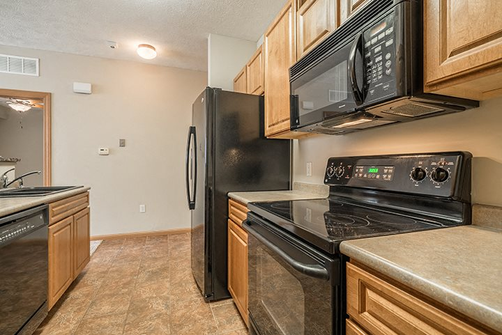 Interiors- Kitchen with flat-top stove at Stone Creek Villas Apartments in Omaha Nebraska