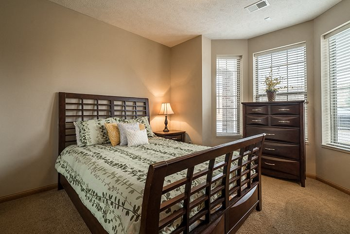 Interiors- Large bedroom with lots of natural light at Stone Creek Villas Apartments in Omaha Nebraska