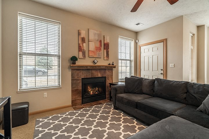 Interiors- Living room with fireplace and lots of natural light at Stone Creek Villas Apartments in Omaha Nebraska