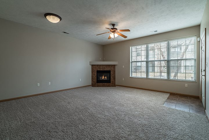 Interiors- Spacious Large Living Room with Fireplace and abundant natural light at Stone Creek Villas Apartments in Omaha Nebraska